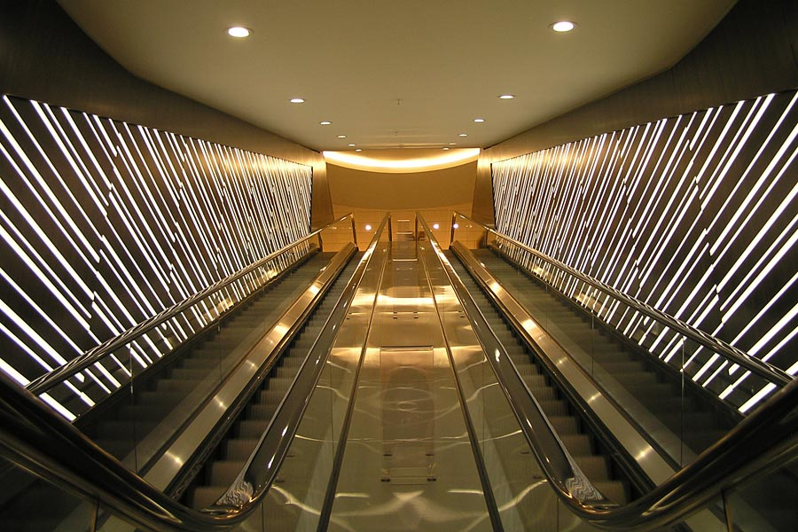 Illuminated 3form Resin And Wood Escalator Feature Wall