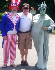 Fred Mazur stands proud with Uncle Sam & Lady Liberty