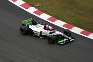 Now at Minardi, Lamy navigates the Spa-Francorchamps circuit.