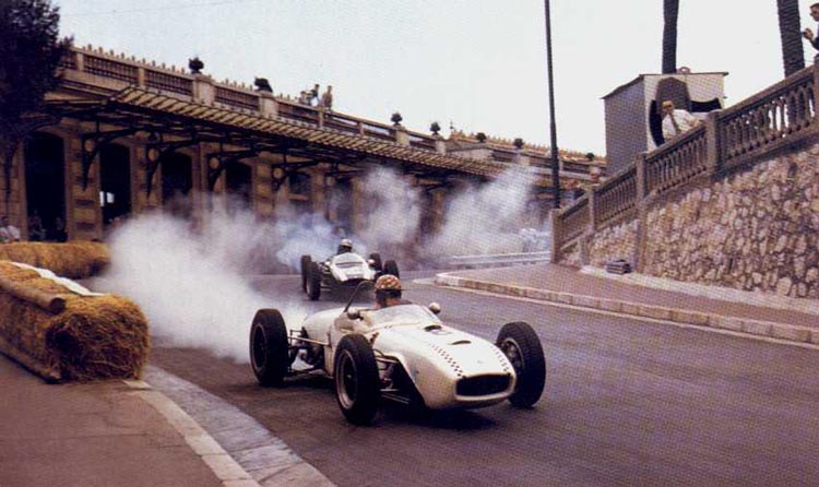 Michael, wearing his distinctive red-and-white helmet, on his way to retirement at the 1961 Monaco Grand Prix.