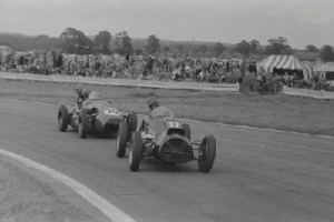 Leslie follows Peter Hughes during the Woodcote Cup, a Formula Libre race in Goodwood.