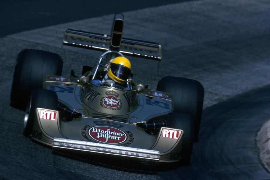 Harald's distinctive black-and-gold Hesketh on its way to eighth place at the 1975 German Grand Prix
