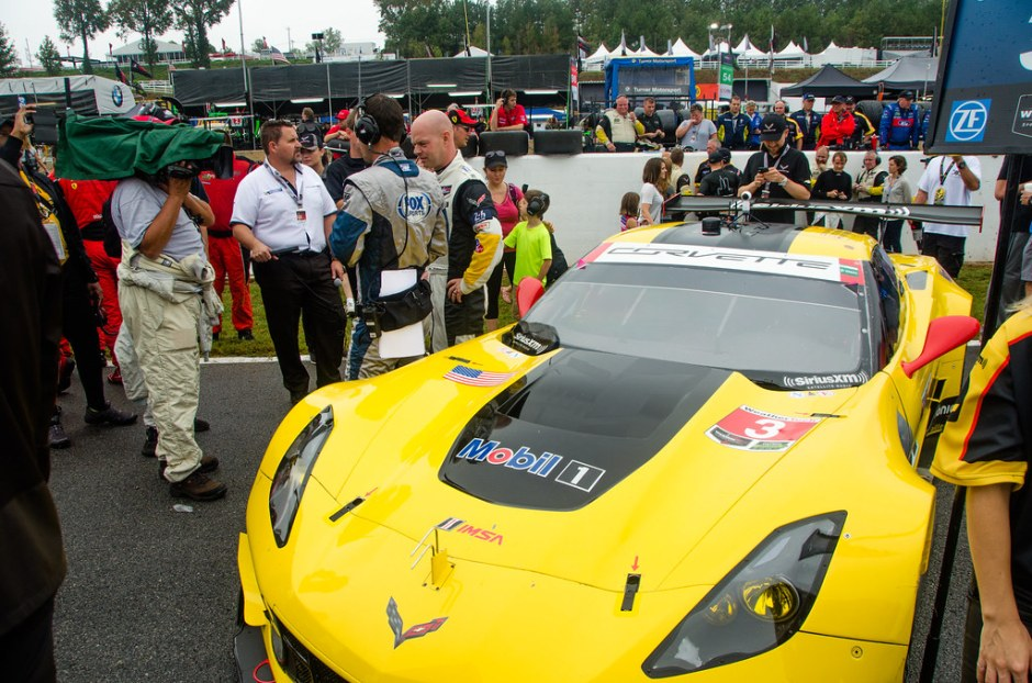 Jan Magnussen stands next to his Corvette. With the team he has won three Le Mans Class wins and a Daytona class win. Photo: Osajus Photography / Creative Commons