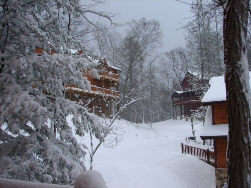 rustic cabins in snow