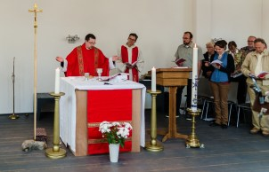 Victor, priest from the Old Catholic Church leads communion