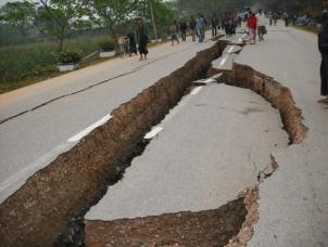 EQ 78407-an-earthquake-damaged-road-is-seen-in-tarlay