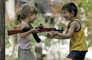 "The title of this picture is ""Kids Playing with Guns."" A perfect illustration of America's unhealthy Gun Culture."