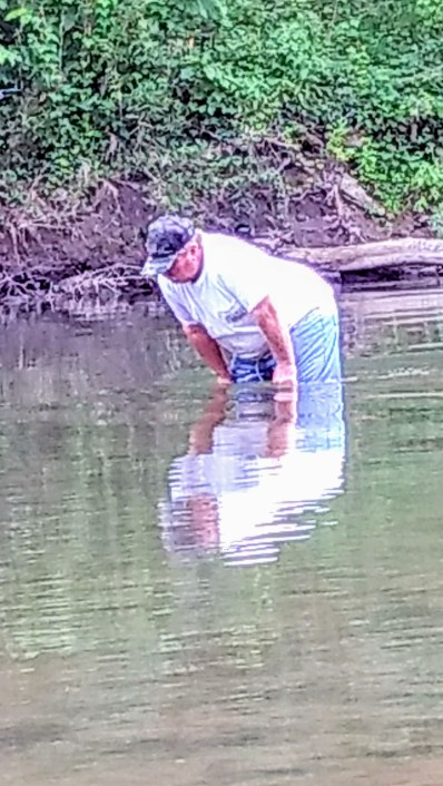 looking for rocks in the creek