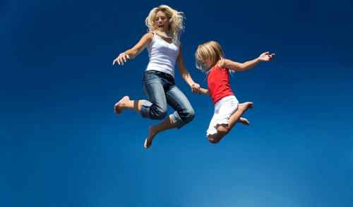 mom and daughter jumping
