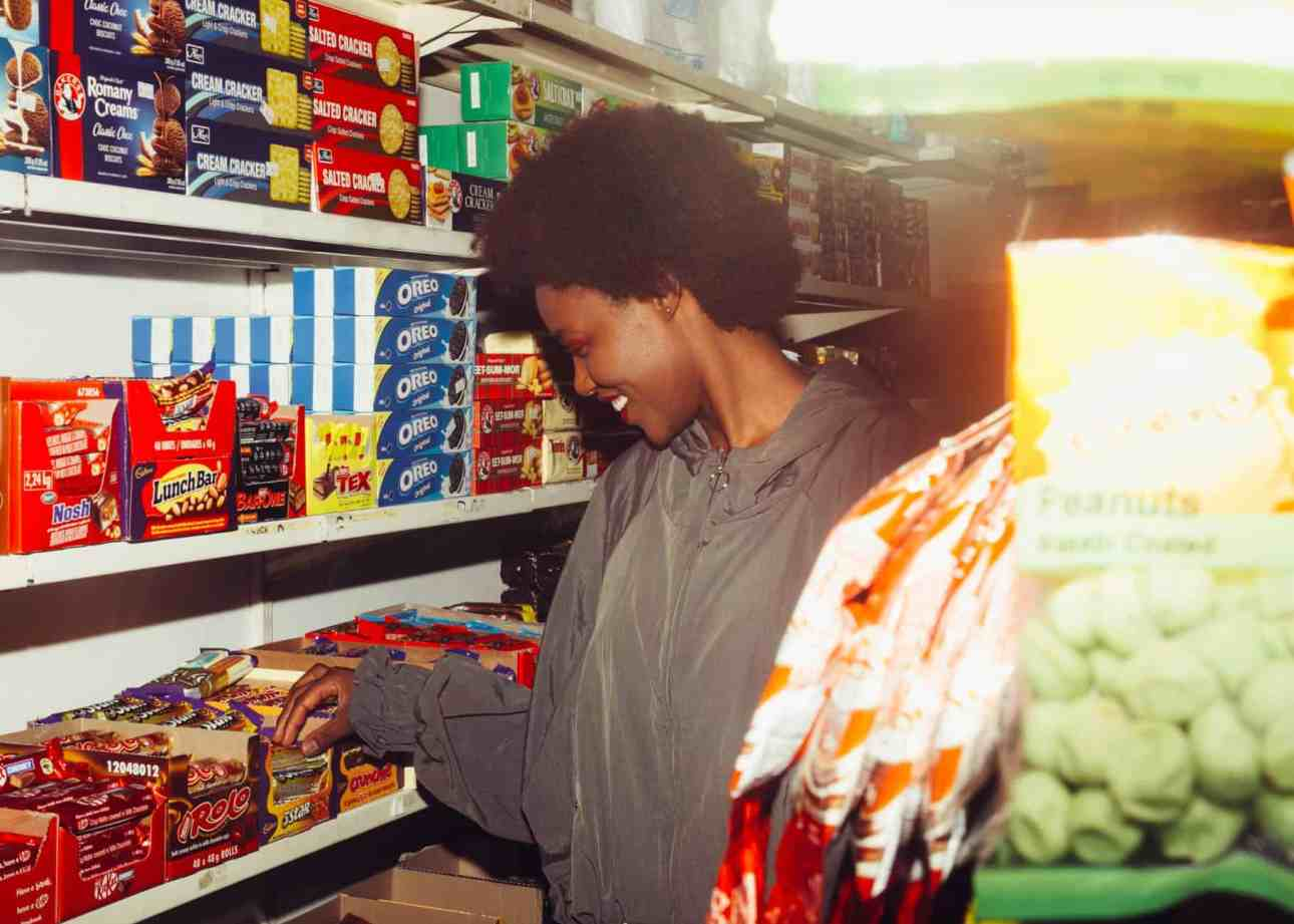 happy black woman shopping in supermarket