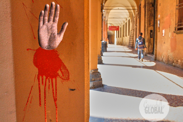 A portico with graffiti of a hand in Bologna, Italy.