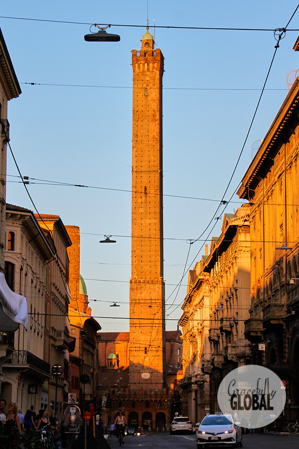 Bologna, Italy's two towers light up in the late afternoon sun.