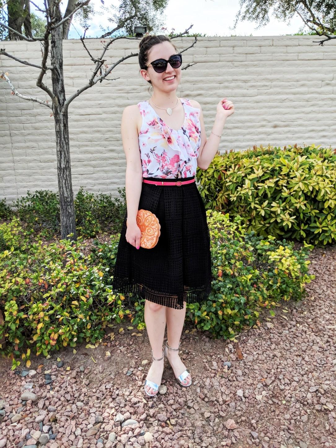 floral ruffle blouse, black skirt, pink belt, orange clutch, spring outfit