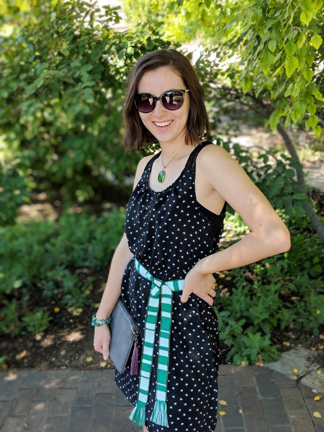 black heart print dress, green belt, green necklace