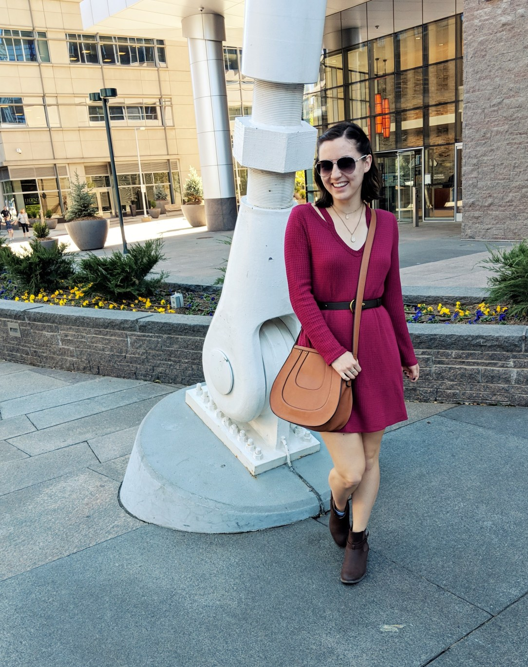 red dress and brown saddle bag