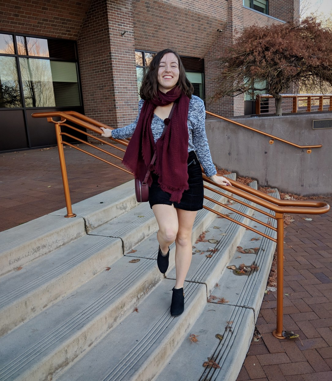 maroon blanket scarf black mini skirt