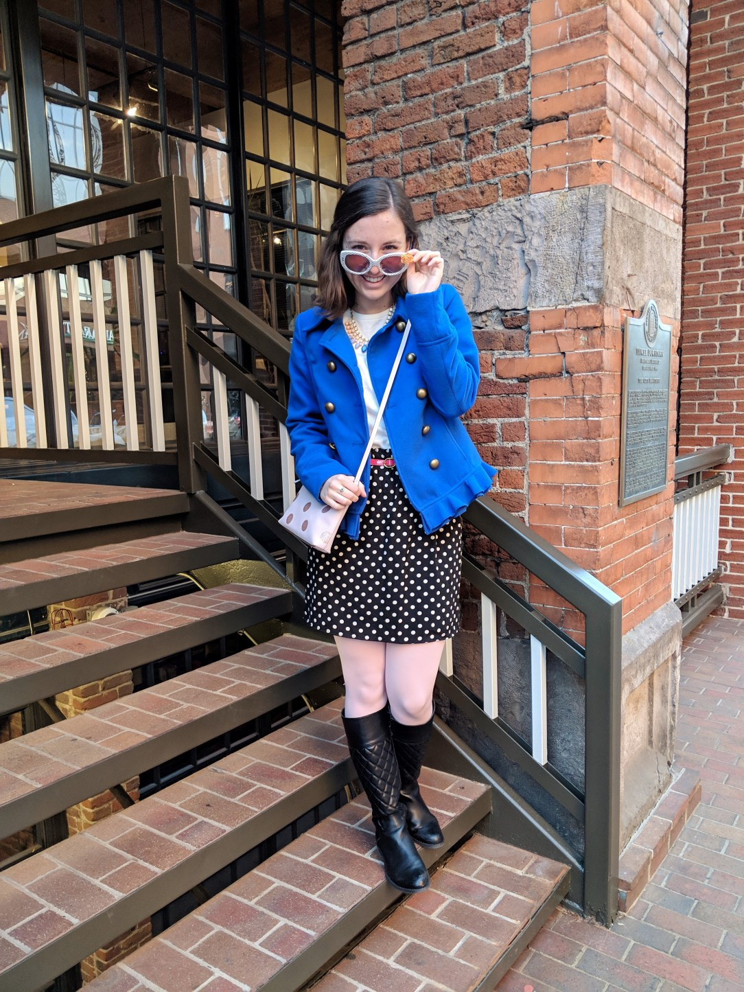 blue cobalt coat with polka dot skirt