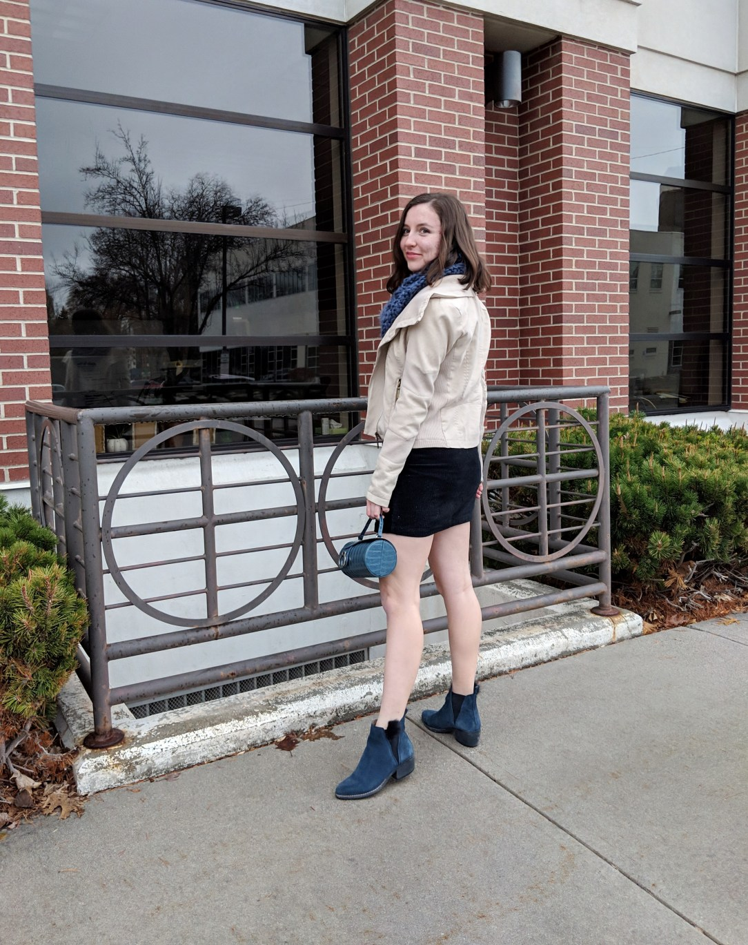 black skirt and beige jacket