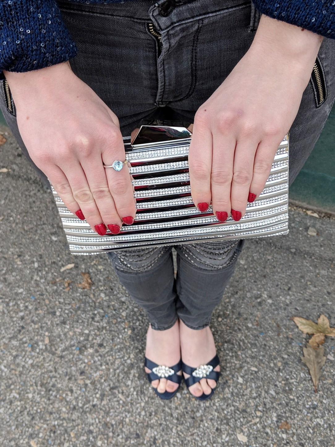 silver purse red nails navy heels