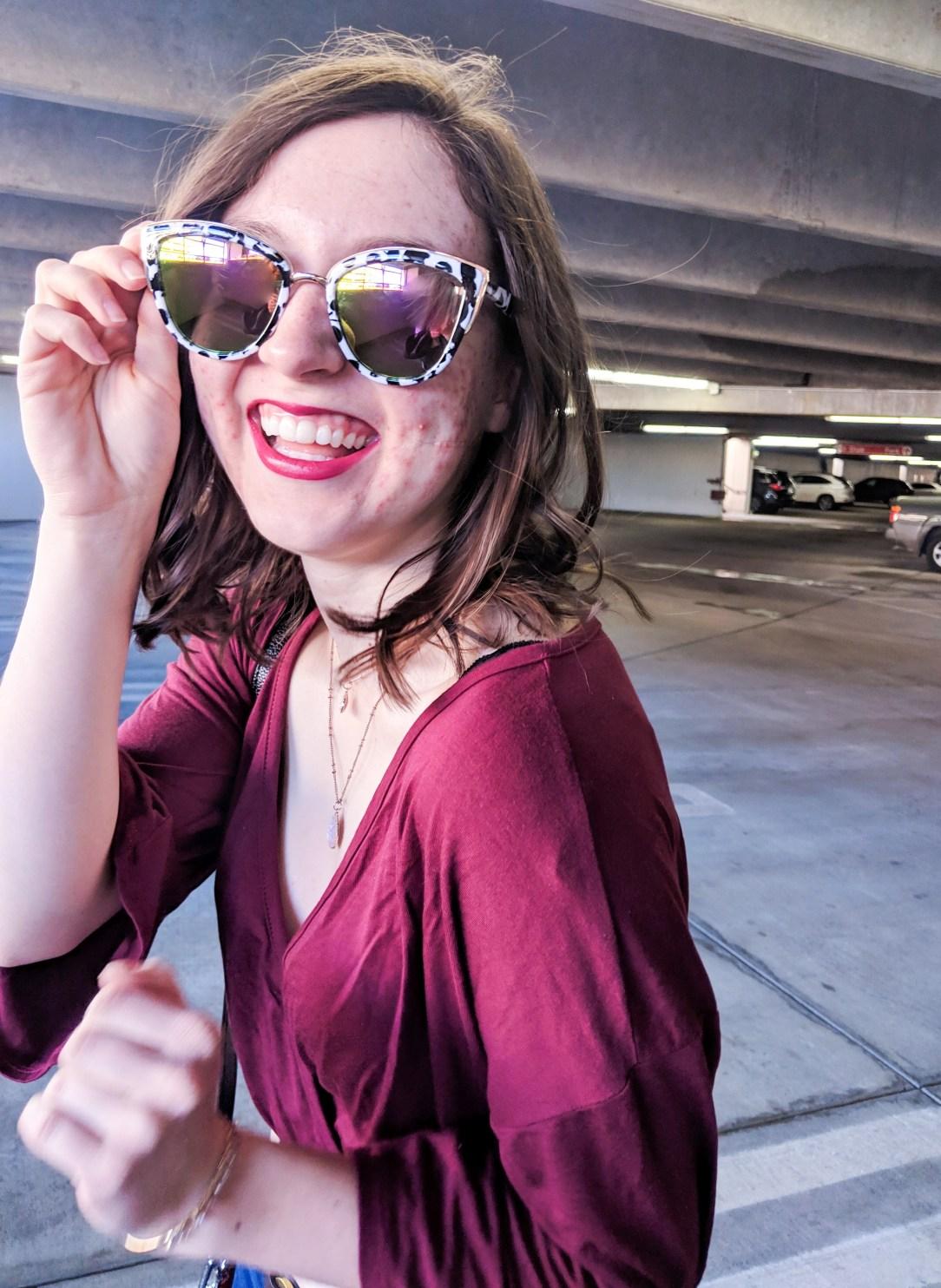 black and white sunglasses and Revlon super lustrous lipstick