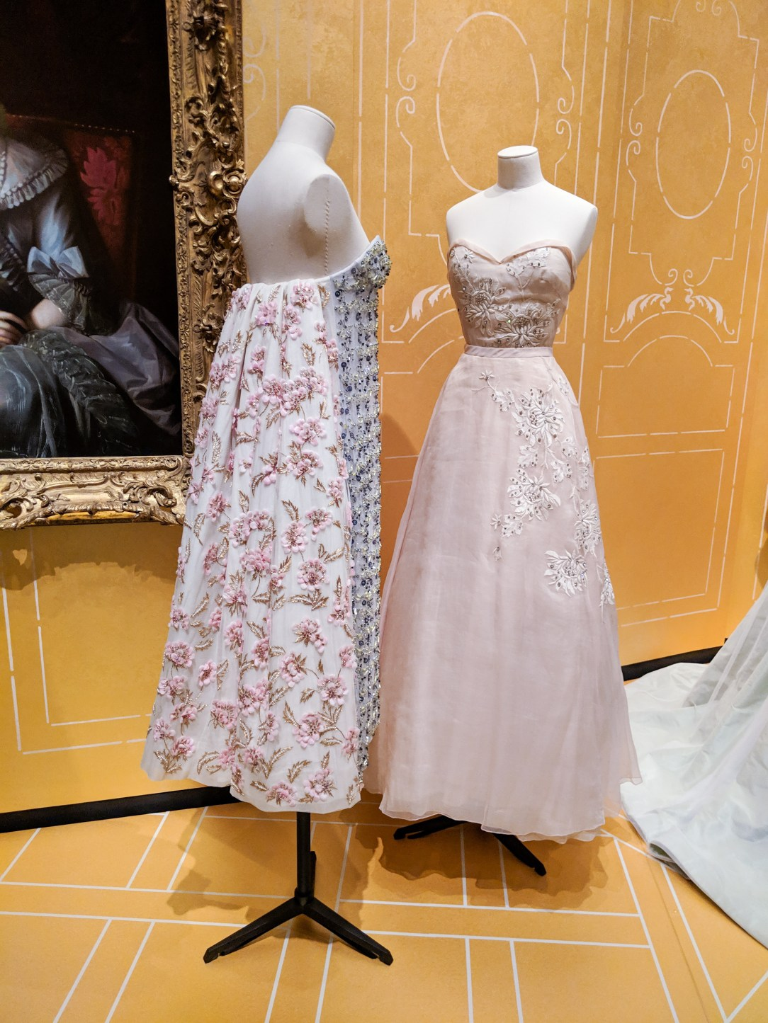 light pink Dior gown and beaded Dior gown