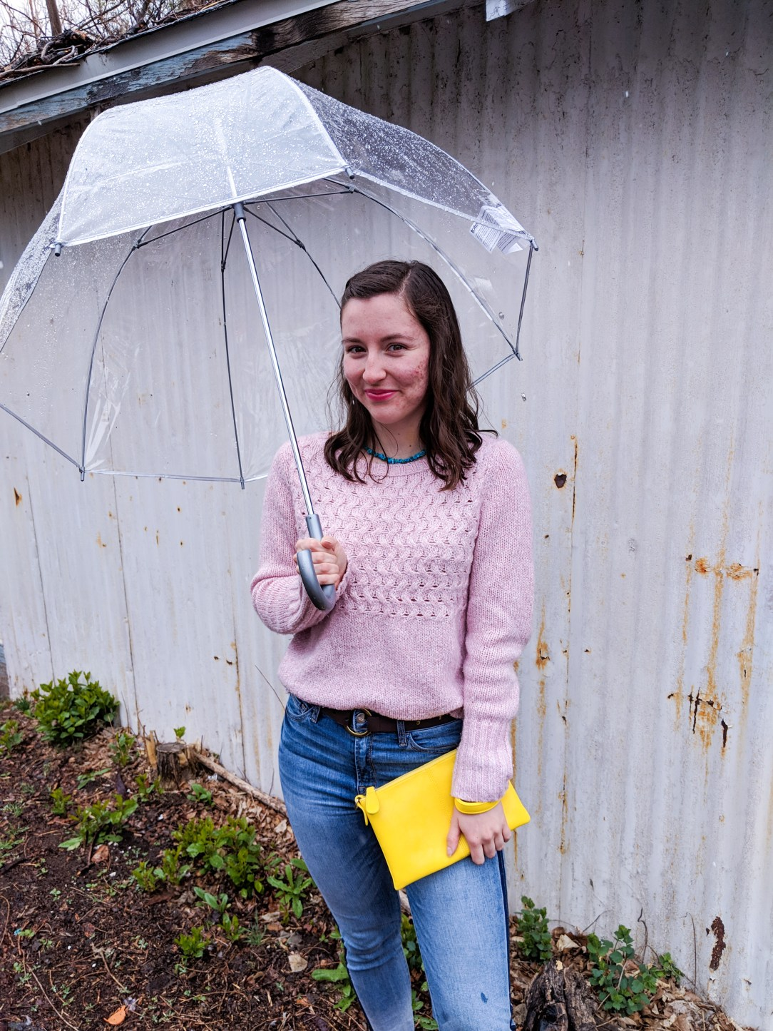 dancing in the rain, rainy day, clear umbrella, pops of color, yellow purse