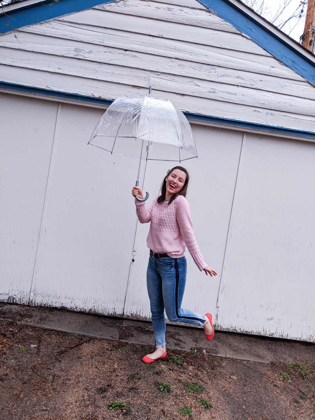 dancing in the rain, cute umbrella, orange shoes, pink sweater