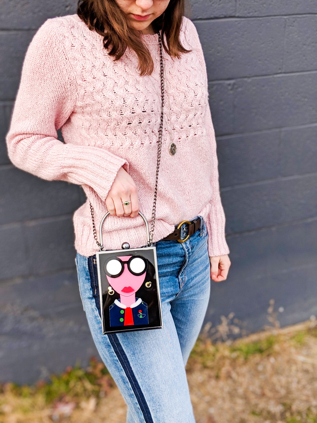 pink sweater, tuxedo stripe jeans, brown belt, art deco purse, street style