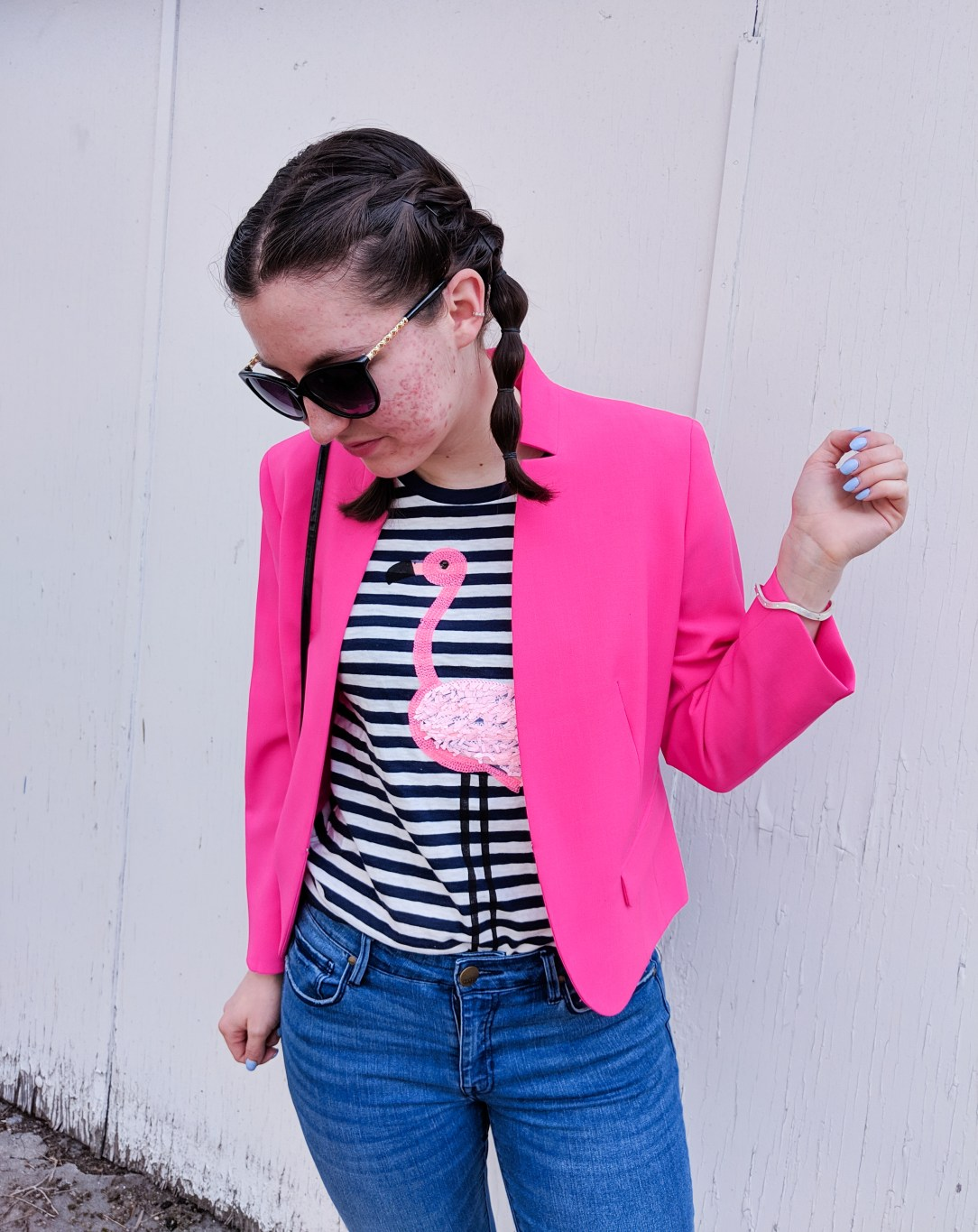 pink blazer, striped flamingo tee, blue nails
