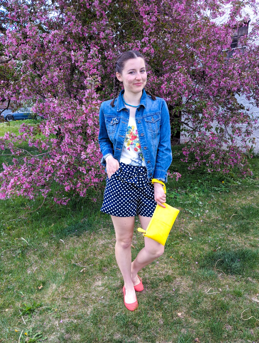 jean jacket, floral graphic tee, polka dot shorts, yellow purse, orange shoes