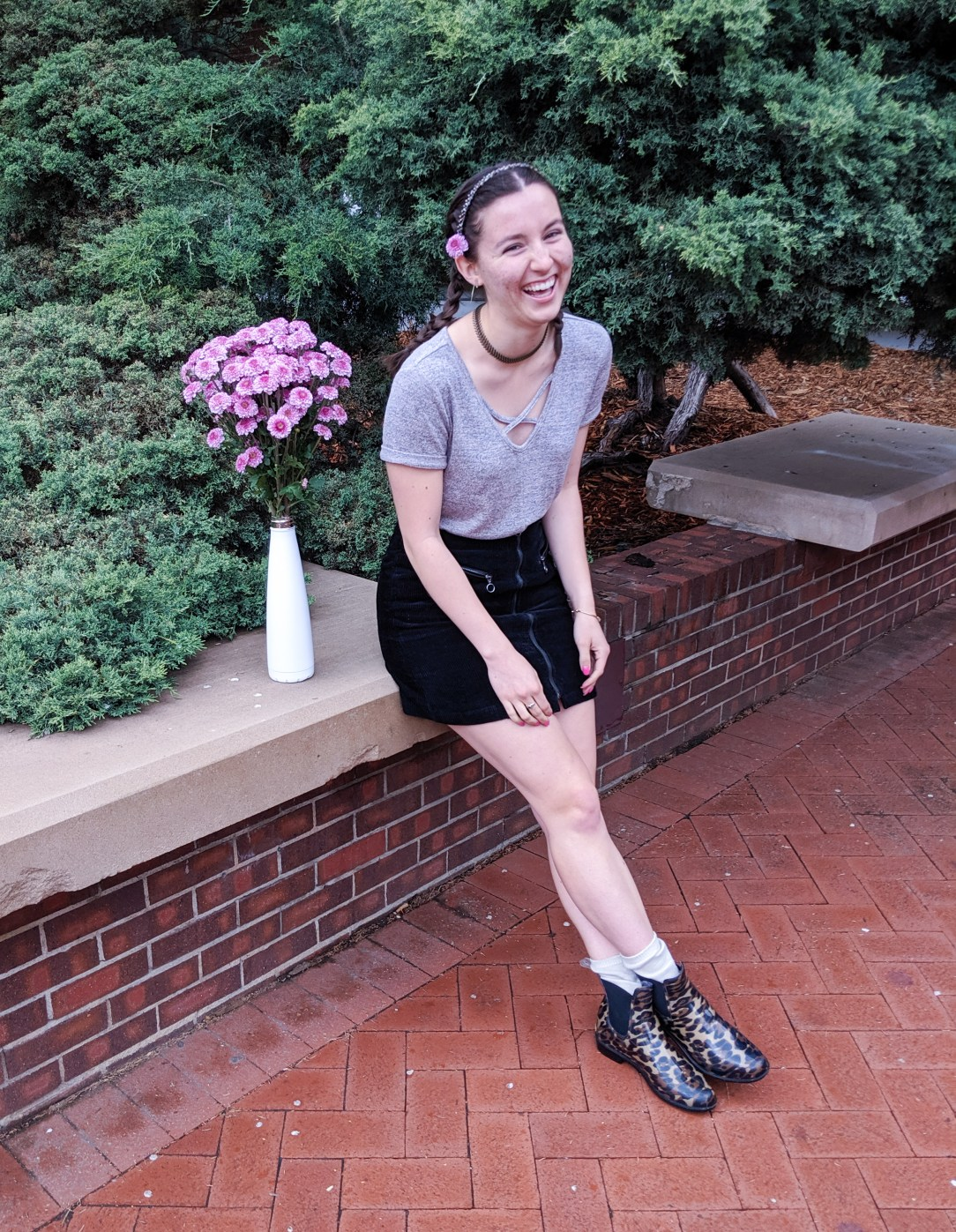 blush t-shirt, black skirt, leopard boots, sparkly headband