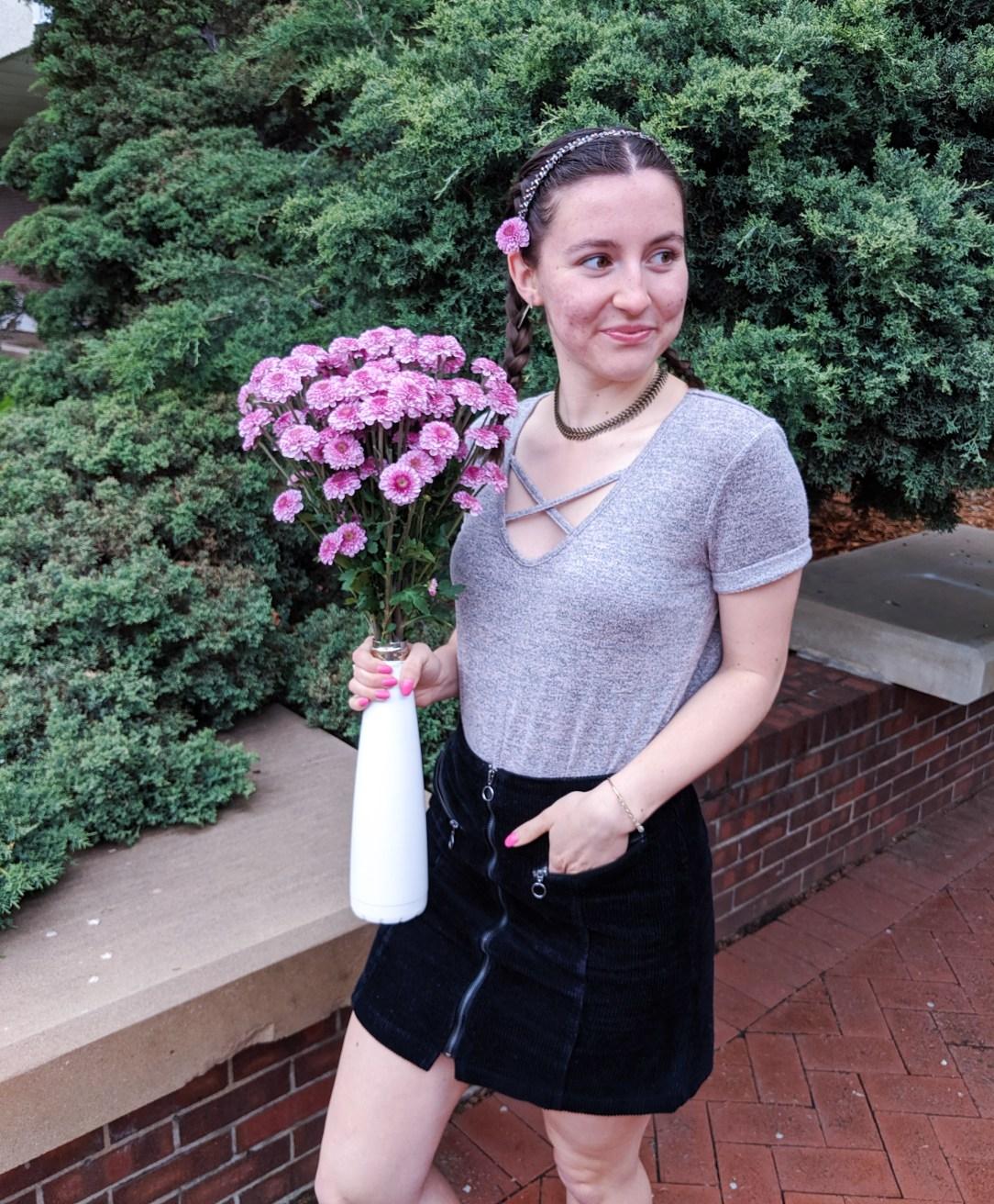 blush t-shirt, black corduroy skirt, pink flowers
