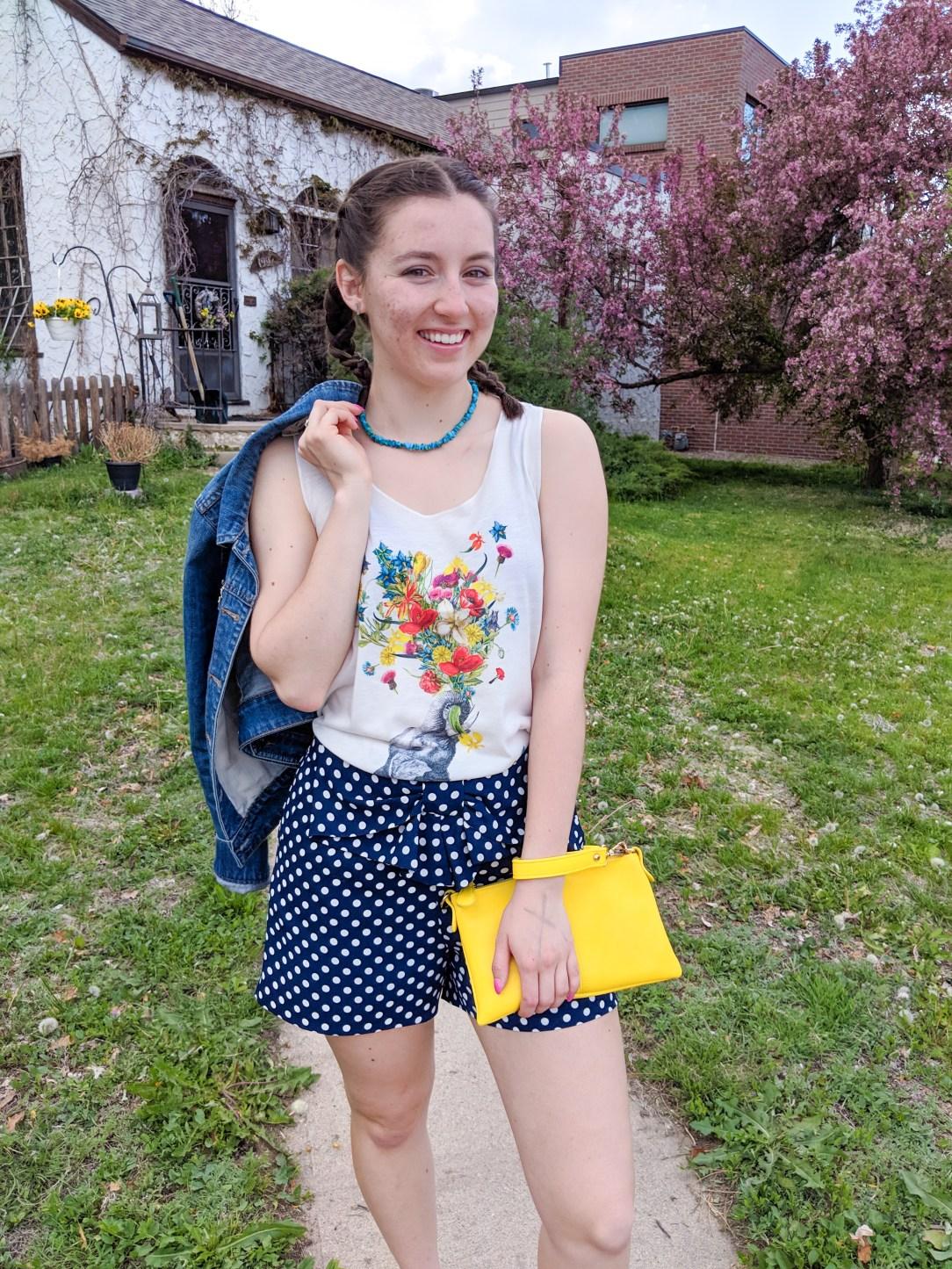 graphic tee, polka dot shorts, yellow purse, jean jacket
