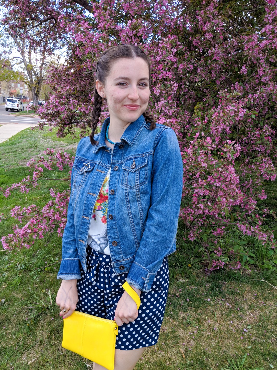 polka dot shorts, graphic tee, yellow purse, jean jacket