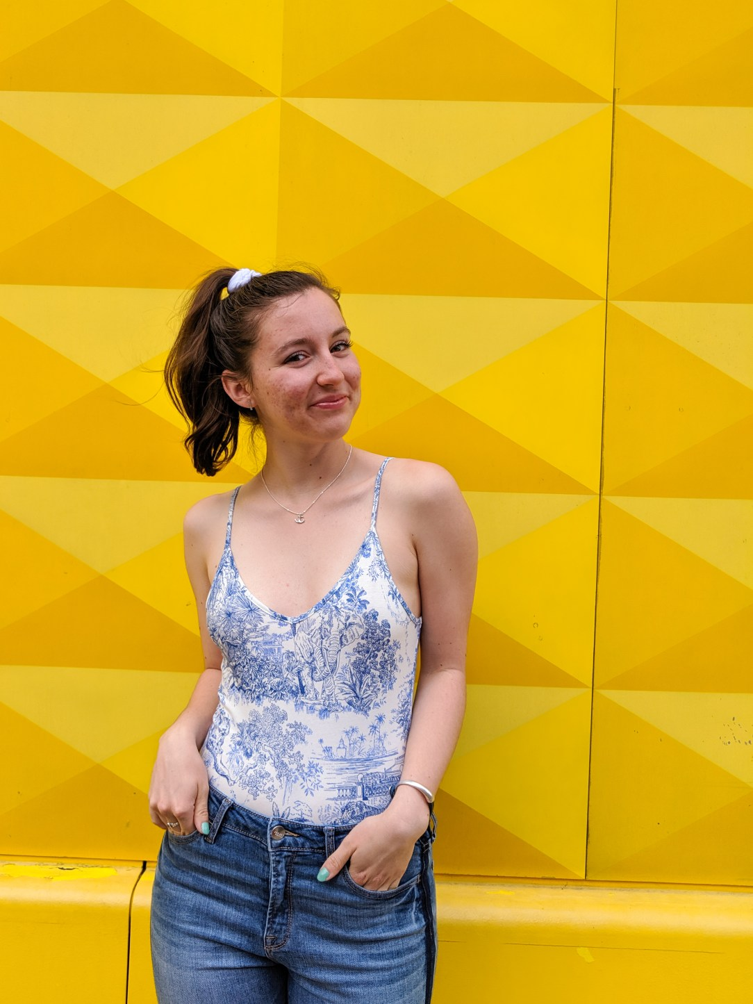 blue and white bodysuit, yellow background, blue and yellow