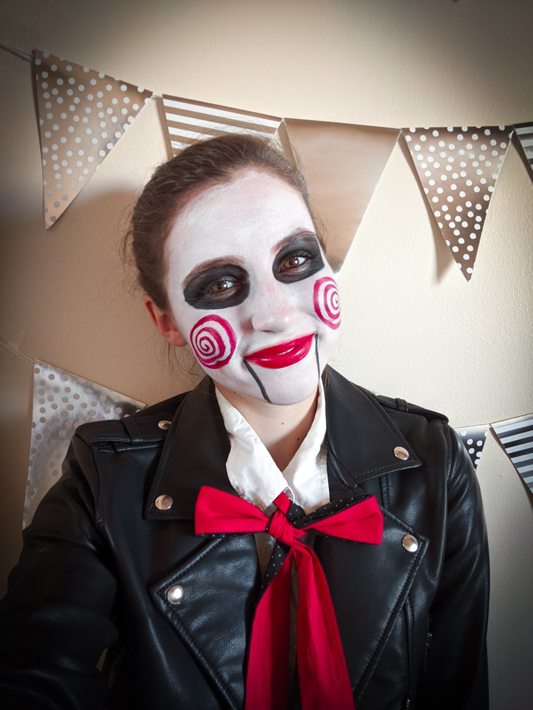 puppet, black pleather jacket, red lipstick