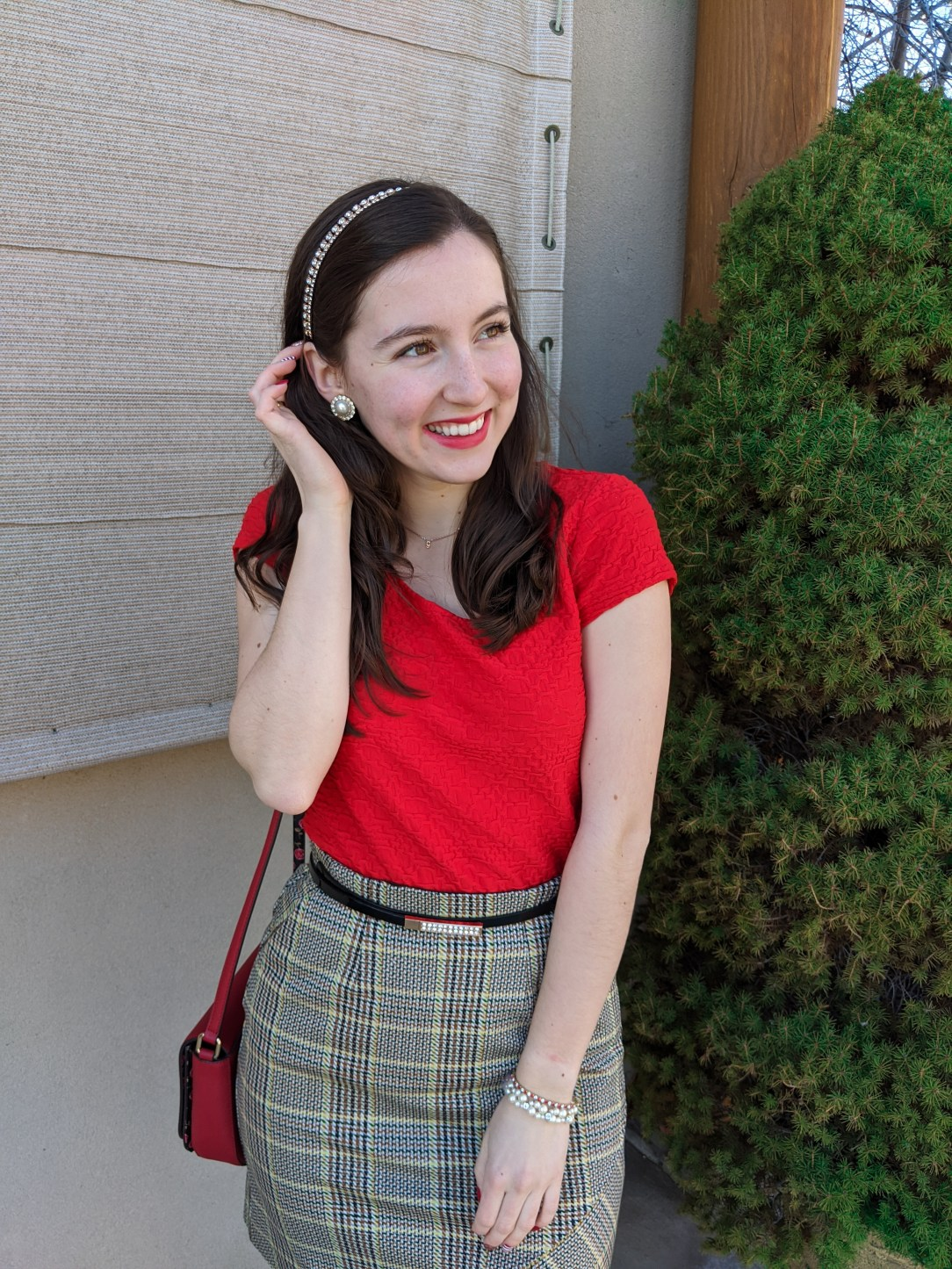 red blouse, plaid skirt, sparkly accessories