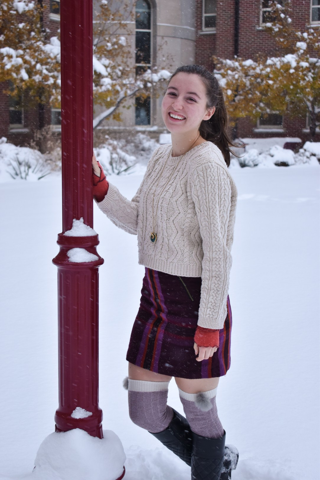 plaid skirt, knee socks, black riding boots, cableknit sweater