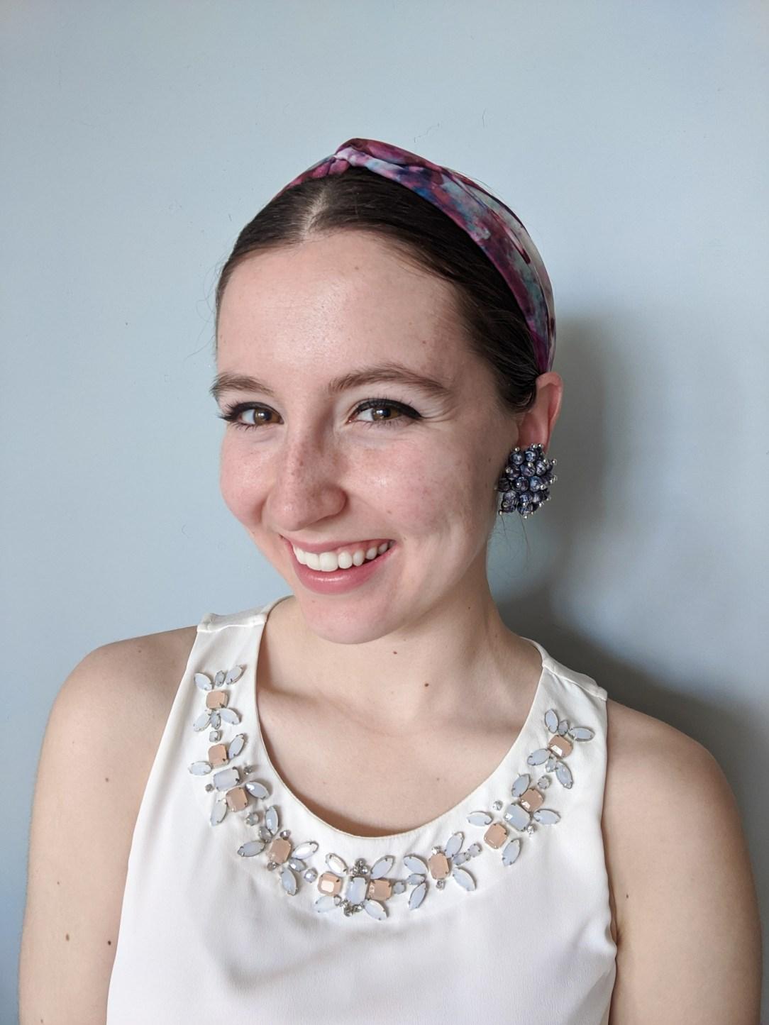 clip-on earring, bedazzled blouse, quarantine hair, third day hair