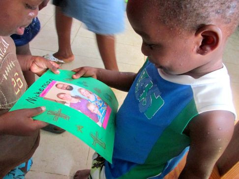 One of our sponsored children, Nickenson, during a 2014 visit in Haiti.
