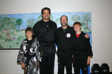 Mark McGee with Black Belts KC, Kyle and Austin Craichy