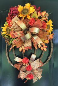 Celebrate fall with a pumpkin door hanger!
