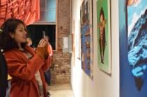 """Sarah Chavez, an artist living in West Philadelphia, enjoys the work shown at the exhibit """"Philadelphia Goddamn"""" during October.   THE SPIRIT NEWS"""