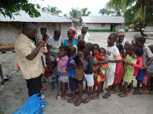 Isaac distributing children's med packs. (Vitamin C and de-worming med).