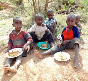 Kenyan Kids Eating on Ground