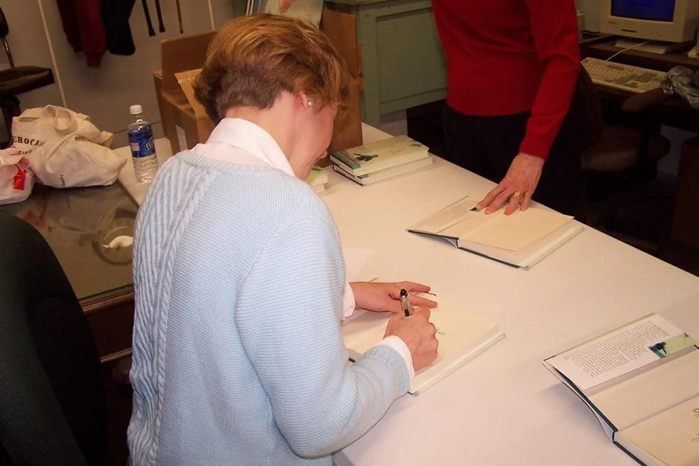 "Gracia Burnham signing copies of her book ""In the Presence of My Enemies"""