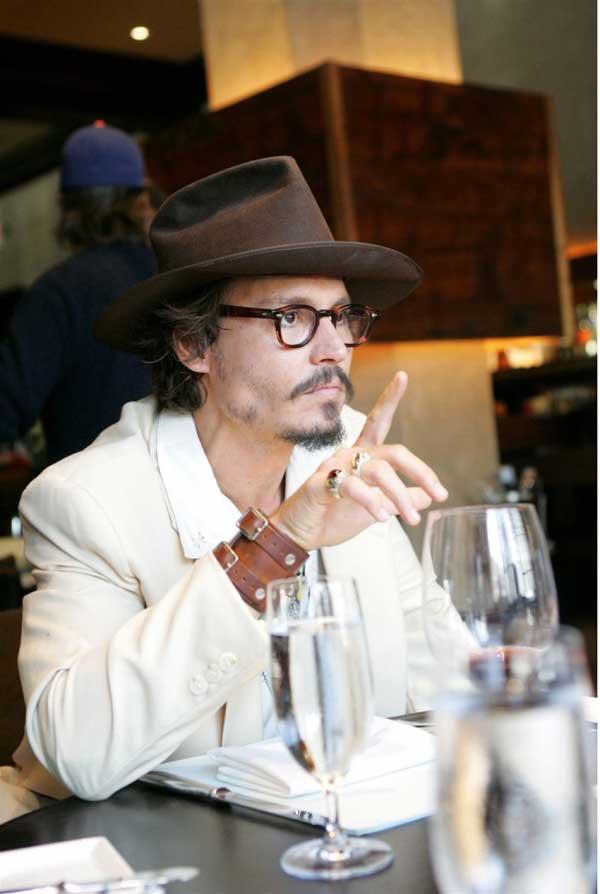 Jonny Depp - Wearing a white suit 2013