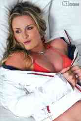 Lindsey Vonn in Lingerie lying on a bed