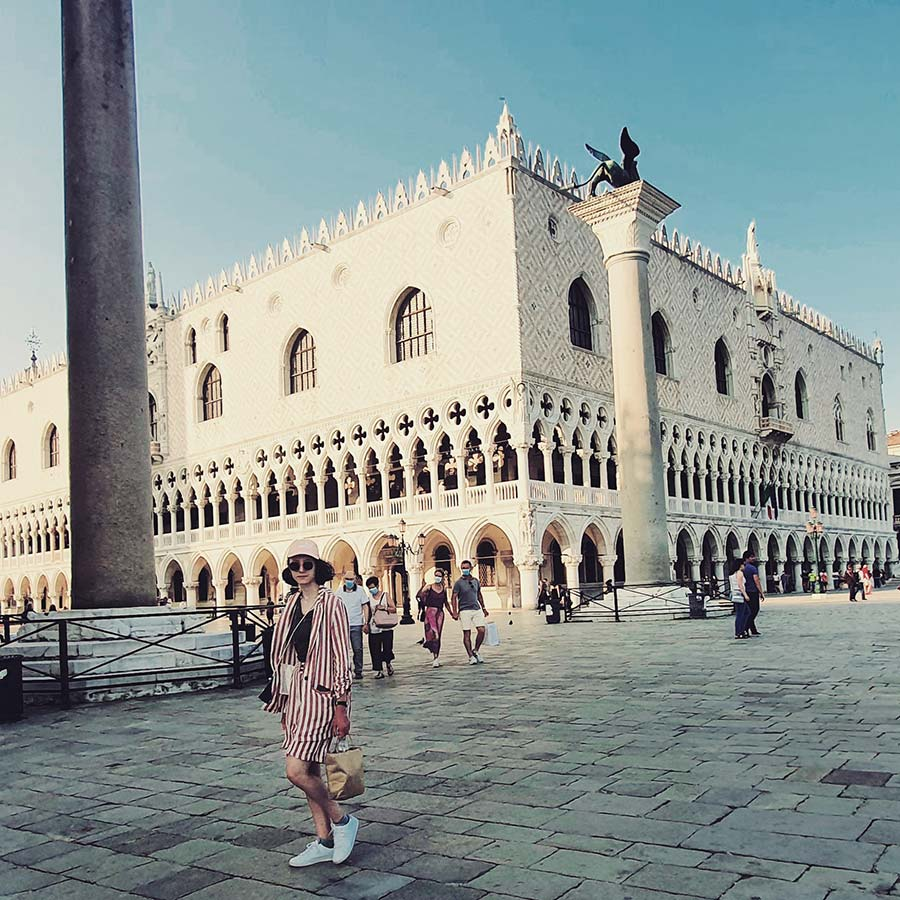 Venice street style striped suit for women Piazza San Marco ITaly
