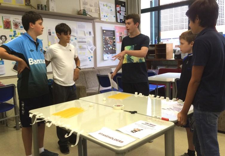 HS student explaining STAKEHOLDERS Station